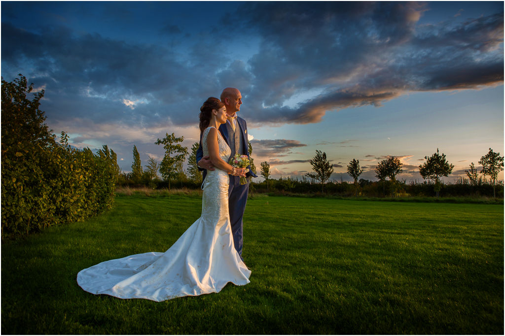 wedding photographer hertfordshire bridal couple at sunset at South Farm, Royston