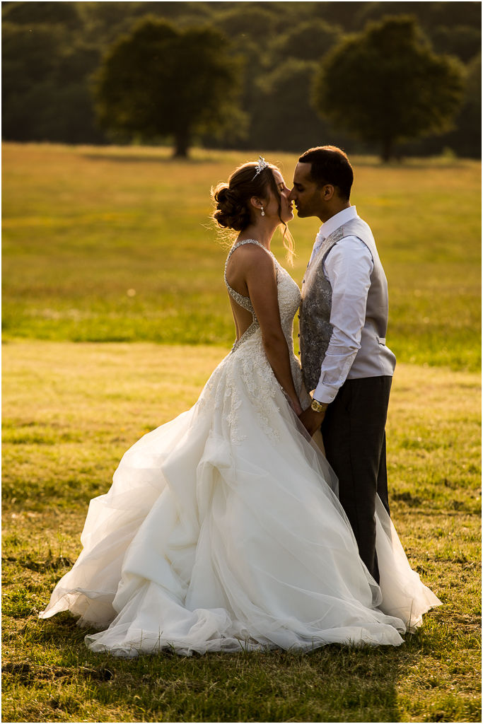 wedding photographer hertfordshire beautiful photo at Knebworth Barns, Knebworth House, bridal couple in evening light